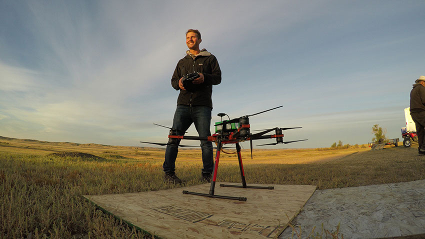 Pilot Jonas Marcinko prepares to launch the drone. Credit: WWF-US / Conservation Media